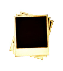 Stack of old worn instant pictures on white background