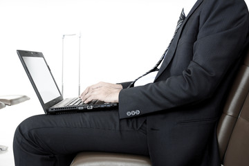 Businessman using laptop computer waiting for the flight