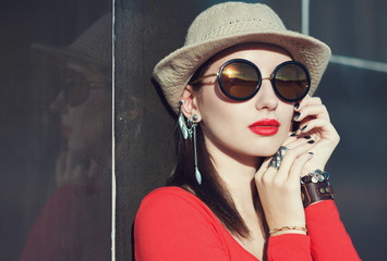 Young beautiful girl in hat and sunglasses