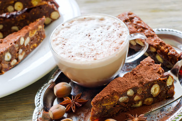 Panforte mocca with dried fruits, nuts and a cup of cappuccino c
