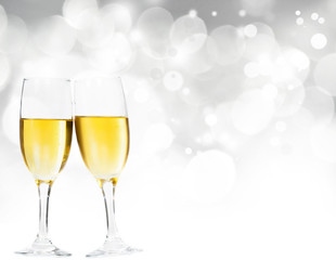 Champagne glasses against holiday lights