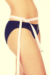 Slim fit woman with measure tape
