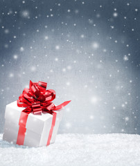 present on snow with copy space for christmas poster