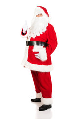 Full length Santa Claus gesturing ok sign