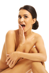 Portrait of surprised nude woman