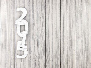 New year 2015 text on wooden background