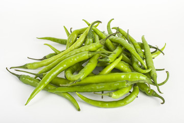 Green chillies on white