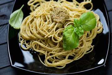 Close-up of spaghetti with basil pesto, horizontal shot