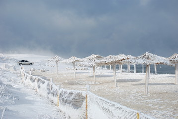 bamboo canopies on the beach in winter