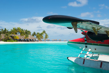 Sea plane, tropical beach resort
