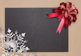 Frame with red bow and snowflake