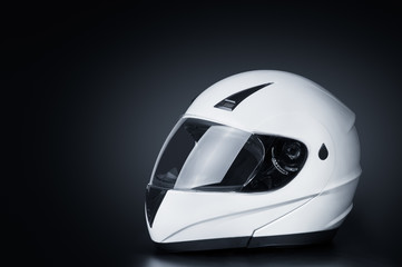 Blank full face helmet in a black background