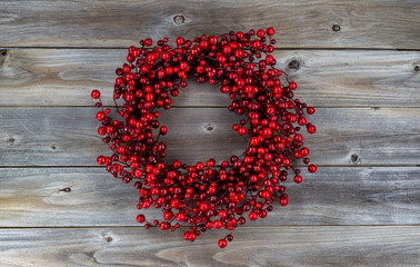 Red Berry Holiday Wreath on Wood