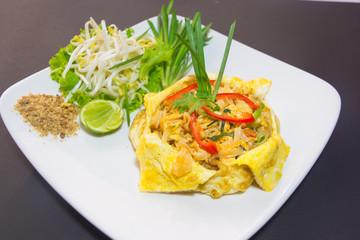 Plate of Pad Thai or phat Thai in omelette