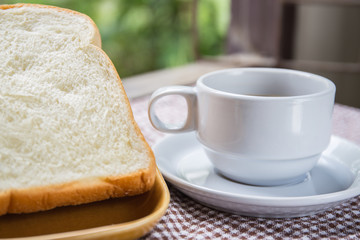 cup of coffee bread on table