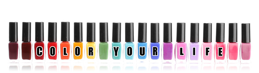 Colorful nail polishes, isolated on white