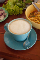Tasty breakfast with  cup of traditional Thai milk tea