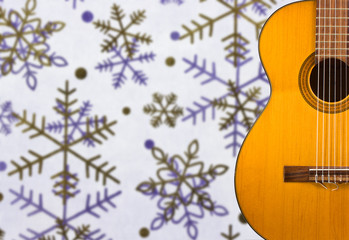 Classical guitar on the background of snowflakes
