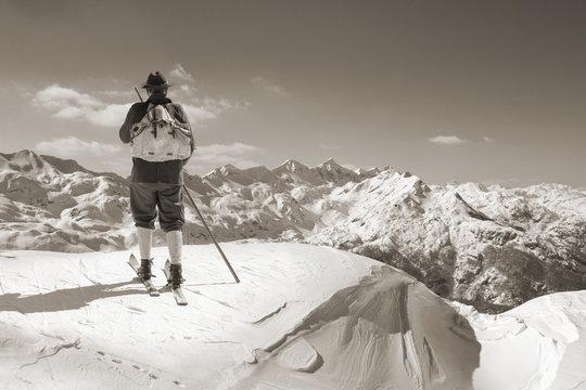 Black and white photos, Sepia Vintage skier with wooden skis
