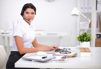 Portrait of beautiful businesswoman working at her desk with