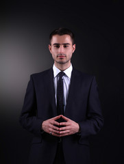 Business man isolated on black background