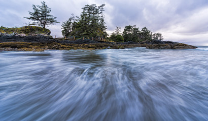 Fototapete - Waves in Motion and Tree Filled Island
