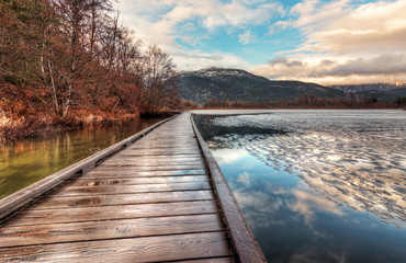 Fotomurales - Boardwalk on Lake with melting Ice