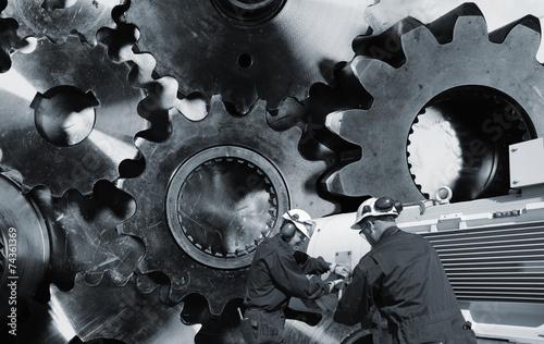 Wall mural mechanic, workers with giant cogwheel machinery
