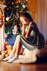 Cute little girl waiting Christmas night