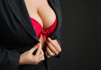 Sexy business lady wearing red bra