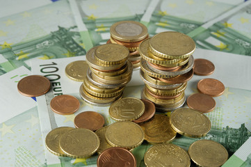 stack of Euro coins to banknotes 100 Euro
