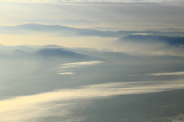 Sky with clouds and mountains background, aerial photography