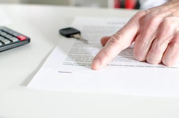 Car salesman showing a sales contract