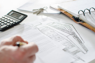 Realtor analyzing financial planning of a house
