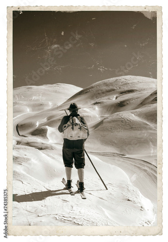Fototapete Black and white photos, Vintage photo with old skier