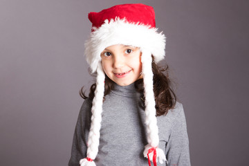 kid with hat of Santa Claus
