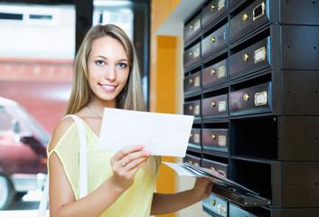 Girl checking up letter-box