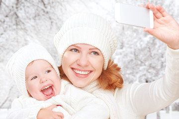 selfie  in winter. happy family mother with daughter