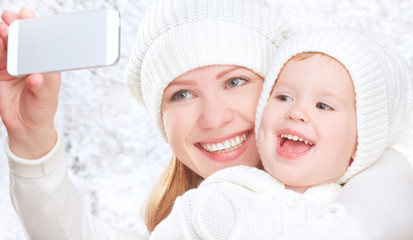 selfie  in winter. family mother daughter photographed self