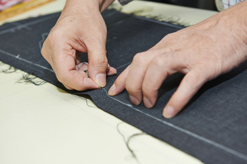 male tailor hands at work