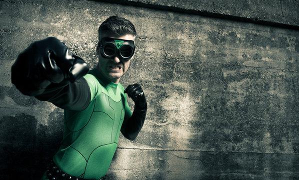 Superhero punching his enemy