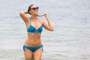 bikini model coming out from water
