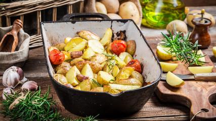 Homemade baked potatoes with rosemary and garlic