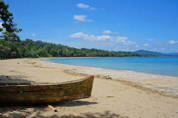 Pristine beach with a dugout canoe Costa Rica