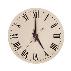 Vintage clock face showing five o'clock