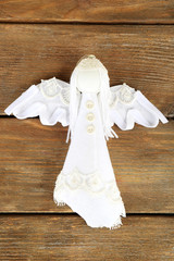 Handmade Christmas decoration angel on wooden background