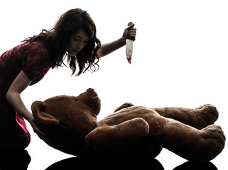 strange young woman killing her teddy bear silhouette Wall mural