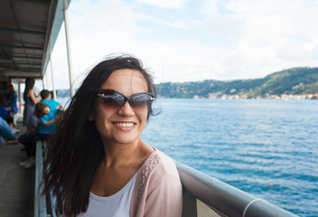 Young woman girl in sunglasses during Bosphorus cruise