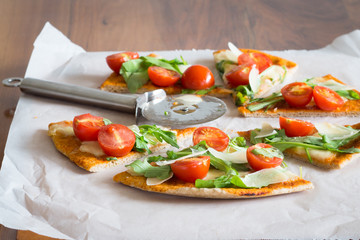 Arugula, Shaved Parmesan and Cherry Tomato Pizza