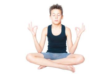 little boy meditating isolated on white
